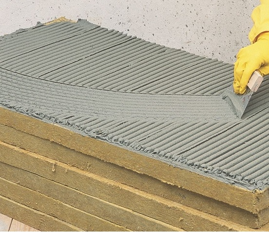 applying-adhesive-to-the-mineral-wool-slab