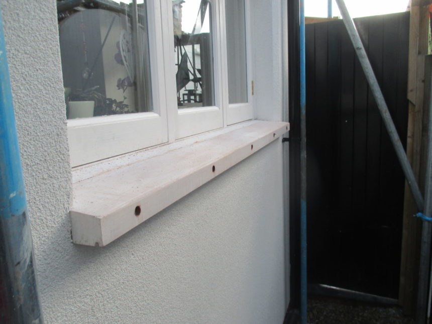 How do you deal with window sills on an External Insulation job?